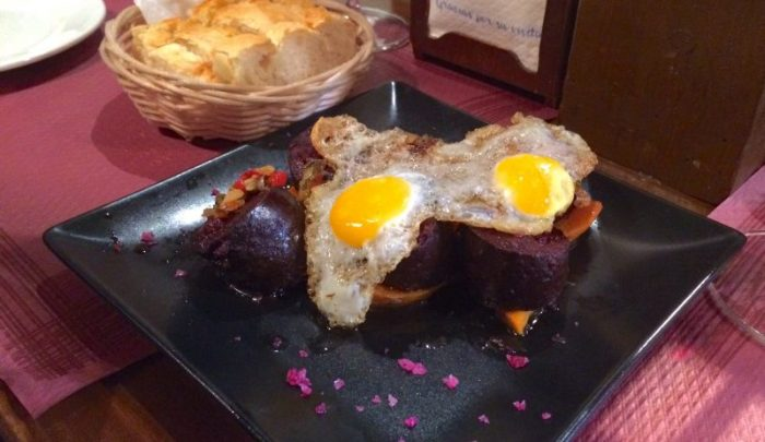 Morcilla with potatoes and fried quail egg at Tapeo de Cervantes