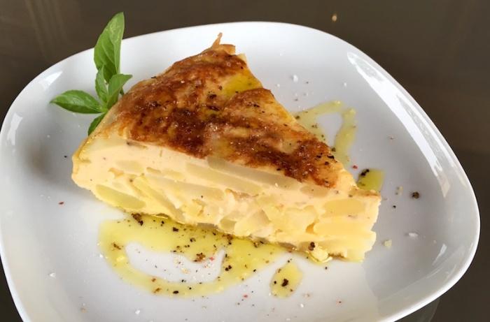 Slice of Tortilla de patatas cebolla