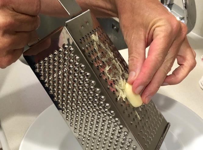 Grate garlic clove