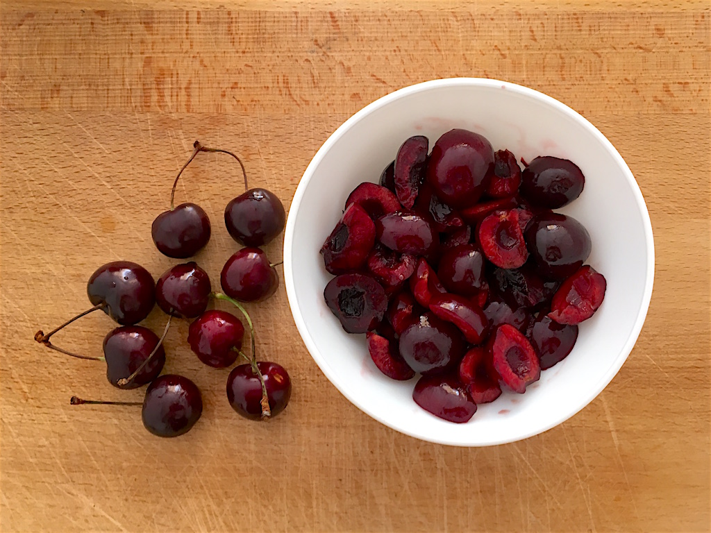 bowl of cherries on wood