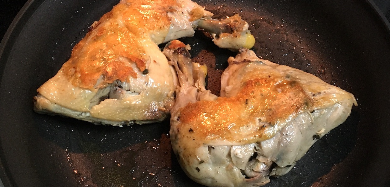 seared chicken confit in pan